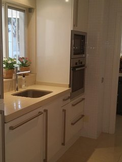 Small Renovated kitchen facing laundry-Vacation Rent Nueva Andalucia Marbella First Line Aloha Golf