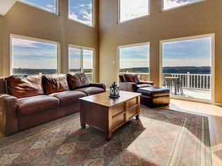 Spacious home w/valley & lake views & lots of natural light from tall windows!