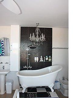 Chandelier over Victorian Bath in Main Bedroom