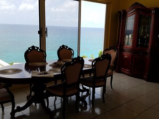 One of the dining areas commanding a 180 degree view of the Caribbean Sea