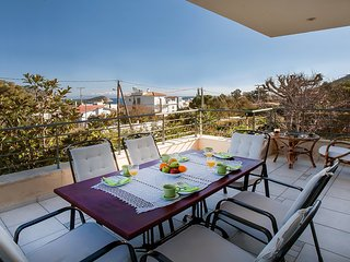 Luxury apartment KHRISTINA 1 with panoramic sea views, courtyard and BBQ.