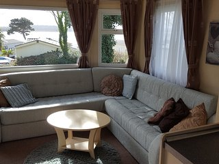 newly upholstered settee and sofa bed with view over sea