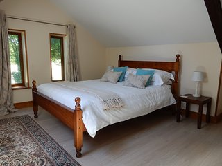 Light and airy master bedroom with king size bed