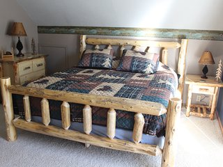 King bed and handcrafted log furniture...private balcony and large room size.