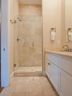 Back King Master Bathroom with all travertine surfaces and walk-in shower