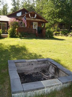Fire pit in the front lawn with views of the Chugach and Talkeetna Ranges.