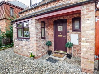 BEACON COTTAGE, superb brick-built cottage, woodburning stove, off road