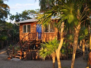 Bamboo Bungalow on the Beach at Leaning Palm Resort, Gales Point