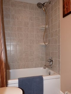 The Hall Bathroom Features a Full-Size, Nicely Tiled, Tub and Shower