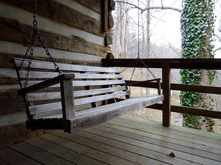 This Porch Swing Overlooks the Mountain Stream Behind the Cabin
