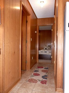 The Bathroom is on the Left, the Master Bedroom to the Right, & the 2nd BR Straight Ahead.