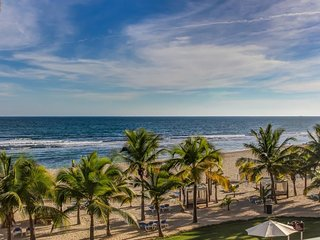 Postcard-perfect oceanfront condo with shared pool & easy beach access