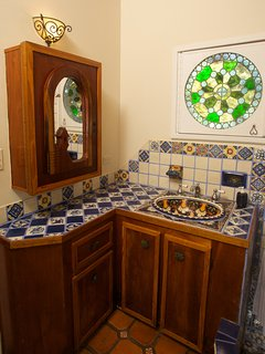 All bathrooms have beautiful tile work.