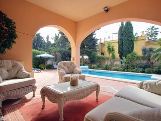 Covered terrace with comfortable furniture for relaxing.