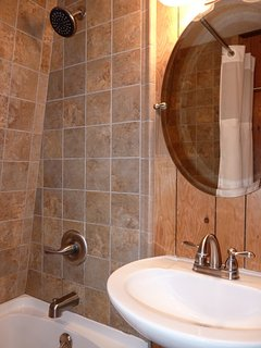Our Bathroom Features a Beautiful Tiled Shower and Full Size Tub