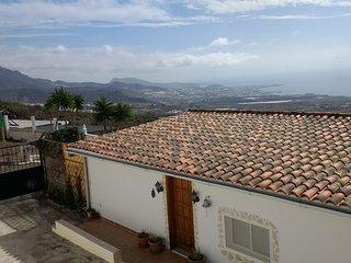 2 bedroom chalet, 2 bathrooms and Hot Tub, sea views hillside location, garden