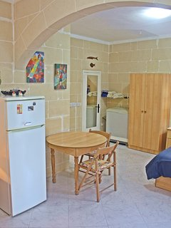 Full-size mirror on shower door, washing machine. Studio fully equipped for a low-budget holiday