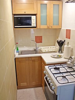 Fully equipped solid wood kitchen with marble top