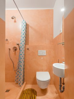 Shower in the bathroom in apricot decor cement.