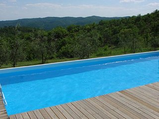Surrounded by a lovely garden with swimming pool and barbeque area, this villa f
