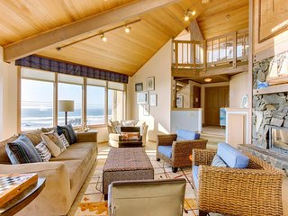 Relax in the hot tub & warm by the fire at this dog-friendly beachfront home!