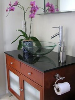 A Granite Countertop & Glass Basin Add Elegance