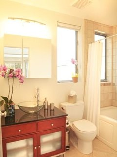 The Bathroom is Warm & Light, featuring a Jacuzzi Bathtub