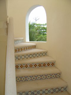Mexican tile accents in winding staircase