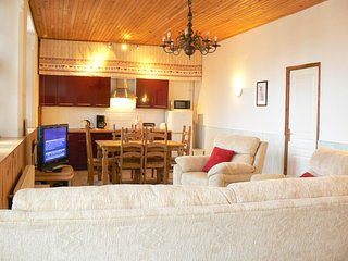 Open plan apartment with fully fitted kitchen, lounge area with flat screen t.v. and freeview