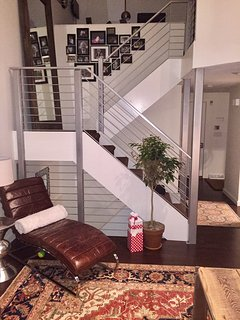 Contemporary staircase to the lower level and 2nd floor