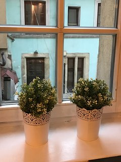 Window in the kitchen with a beautiful view of old Krakow buildings