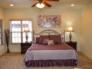 Master bedroom with king bed and access to deck