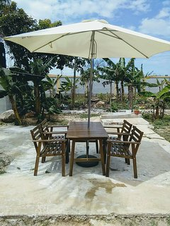 Outdoor patio with table and umbrella for your enjoyment. Can accommodate 16 people outside.
