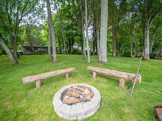 Firepit near the water. Cozy place to gather for s'mores and more in the evening.