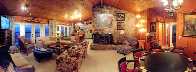Panoramic of our cheerful living room with large fireplace and mountain view!