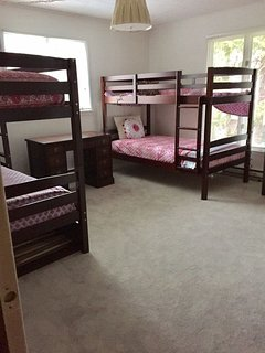 Bedroom 2: two sets of twin bunk beds and a pullout trundle, sleeps 5.