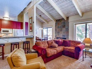 Spacious mountaintop condo with fireplace and shared sauna, pool, & hot tub.