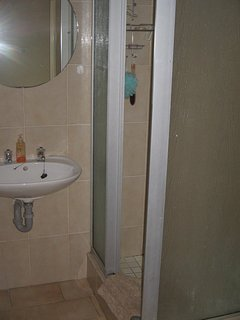 Bathroom with basin, shower and toilet