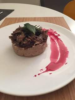 Wild boar in two different cookings served on a chestnut purè with raisin and pomegranate reduction