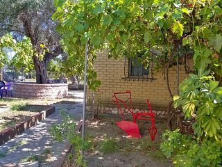 2 charming  and cosy  Apts X 4 with beautiful garden close to the beach in Corfu