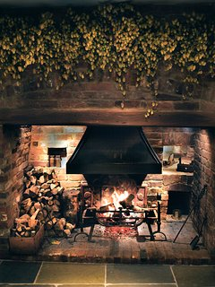 Large Inglenook fireplace with traditional Kentish hops garland.