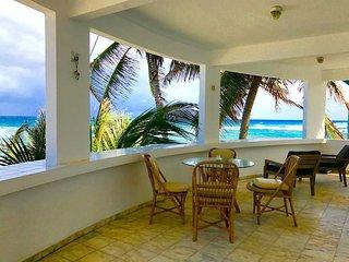 Upstairs balcony, always breezy overlooking the ocean