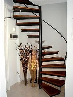 feature spiral staircase to the 2 bedrooms and bathroom upstairs