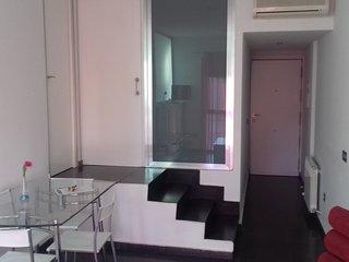 Apartamento 1E- cama matrimonial con sofá-cama en salón de AT Los Angeles, Alcazar de San Juan