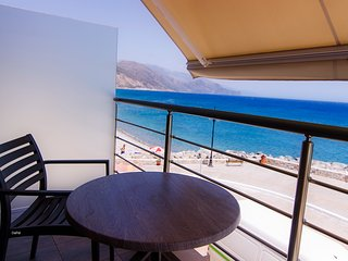 Sea Views at Gonis Apartment next to a Beach. Walk to bars, restaurants & shops.