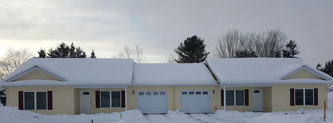 The duplex, conveniently located in the heart of Presque Isle, Maine on a quiet residential street.