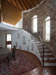 The hand tiled turret staircase with custom ironwork