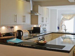 Kitchen area has view of beach.