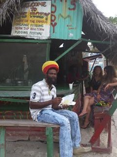 Enjoying 'ital' Rastafari food, with guests, at cook shop in Negril