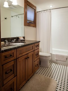 Bathroom with shower/tub combination.